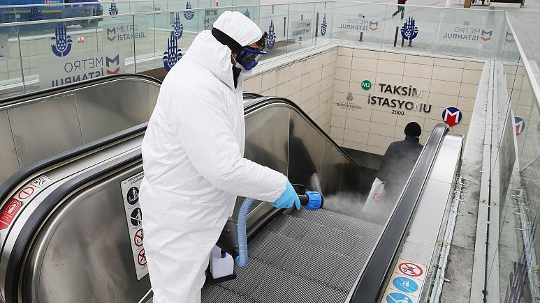 An-agent-disinfecting-the-subway-entrance-to-Taksim-Square-in-Istanbul